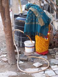 The Streets Of Delhi - Slum Dwellers buckets